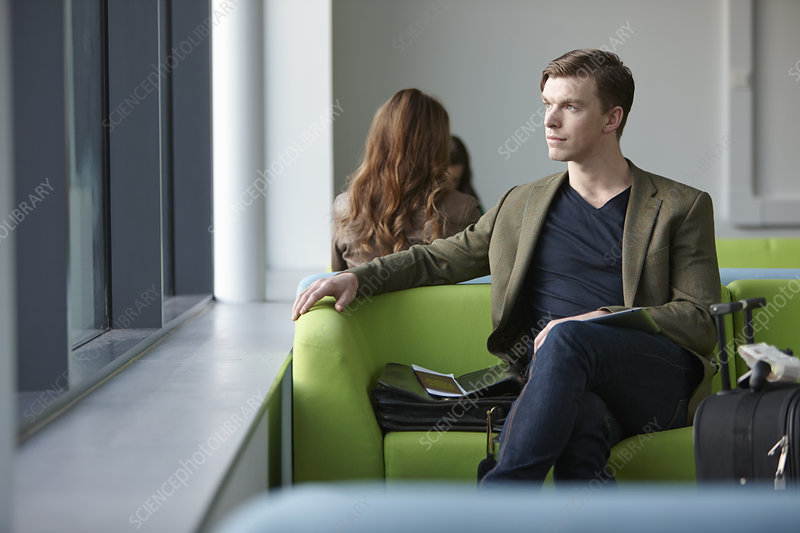 Young man in departure lounge