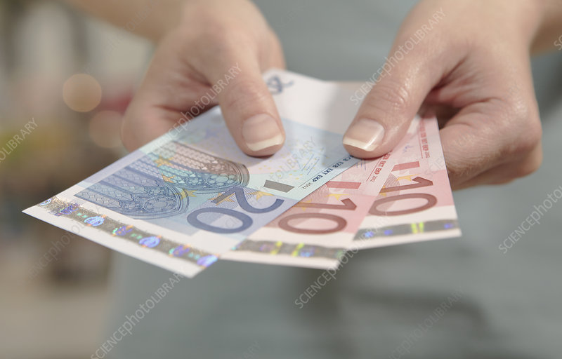 Female hands holding euro notes