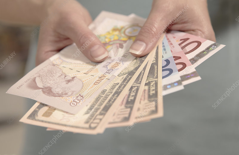 Hands holding currency