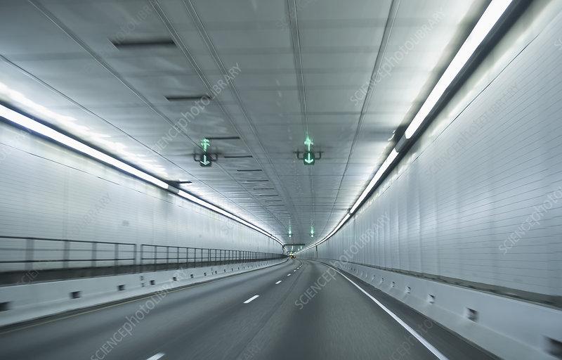 Speeding through empty road tunnel