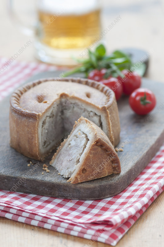 Melton mowbray pork pie on chopping board