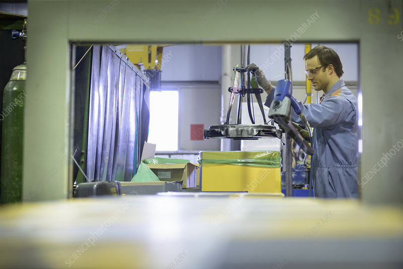 Worker on packing line in factory