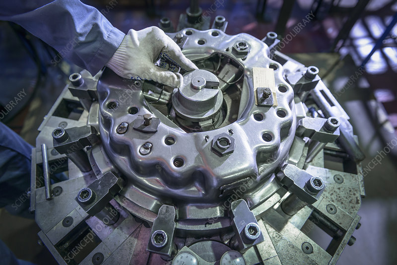 Engineer assembling industrial clutch