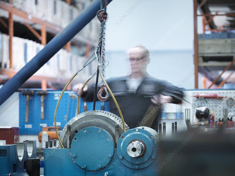 Engineer assembling industrial gearbox