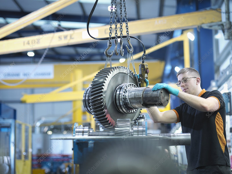 Engineer assembling industrial gearbox
