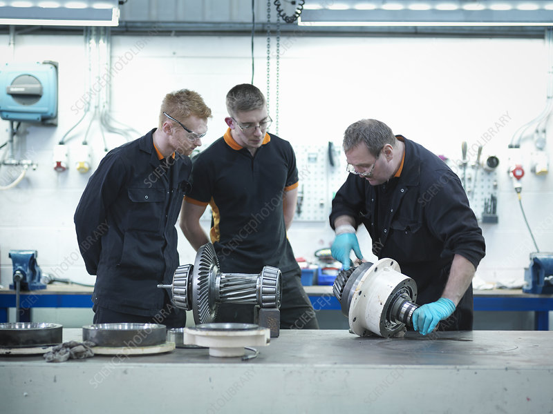 Engineer teaching apprentices