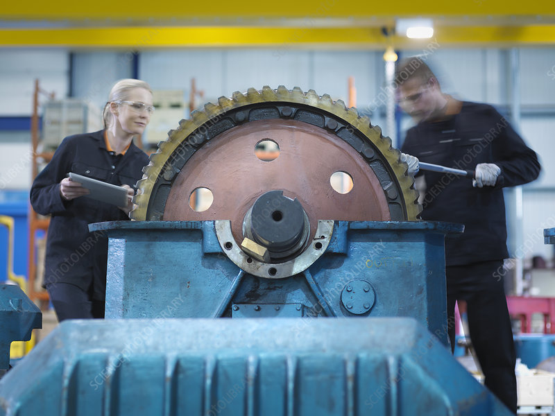 Engineers repair industrial gearbox