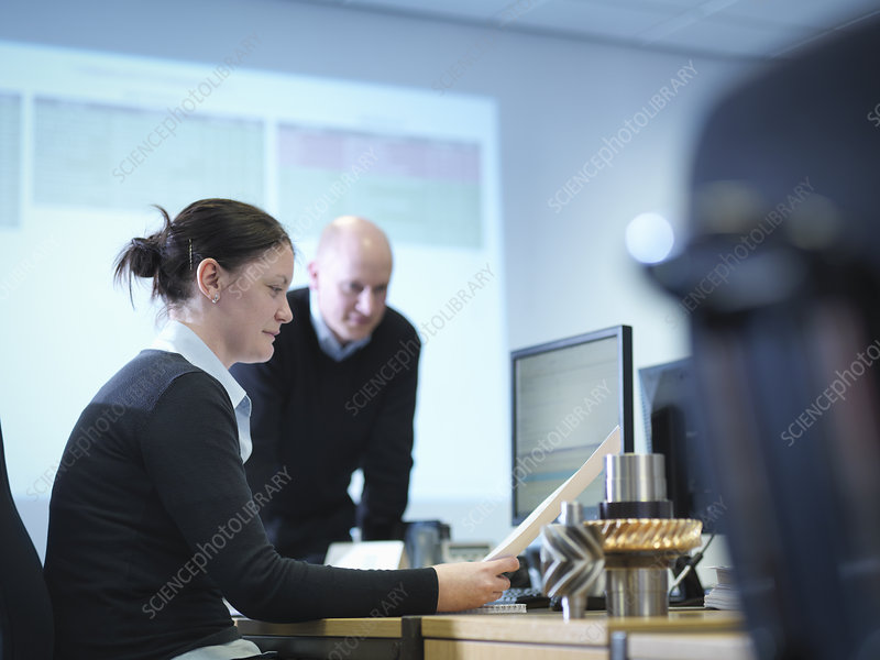 Engineers using computer aided design