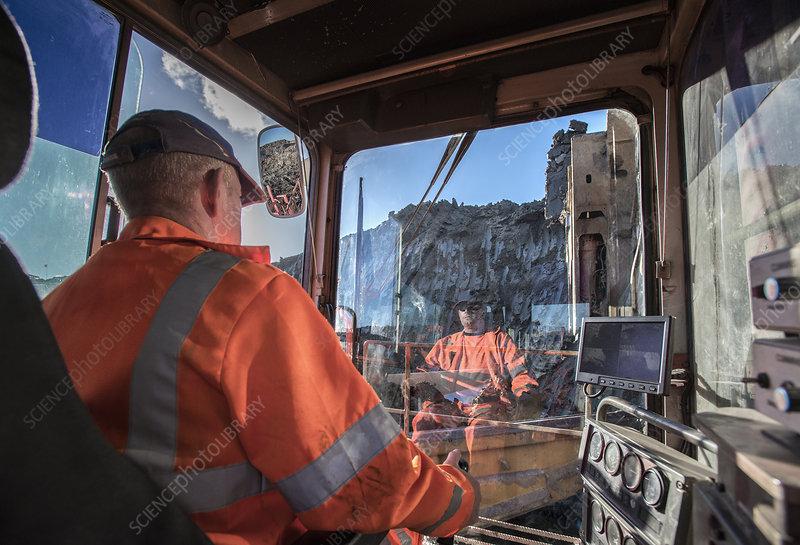 Excavator driver in digger cab
