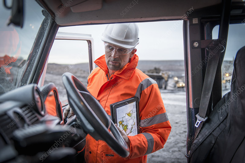 Geologist holding tablet in truck