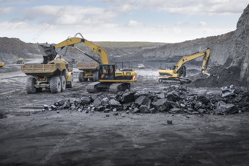 Machines working in surface coal mine