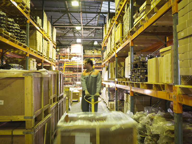 Worker in storage area of factory
