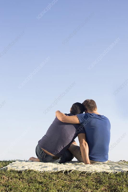 Male couple hugging