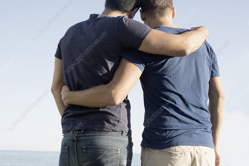 Male couple with arms around each other