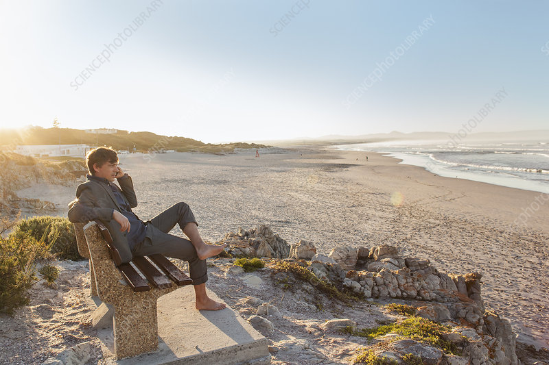 Man relaxing on beach bench