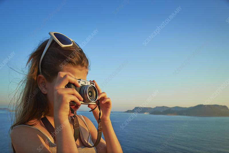 Girl taking photographs on holiday