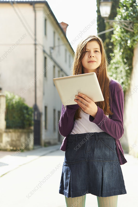 Girl with tablet on street, Italy