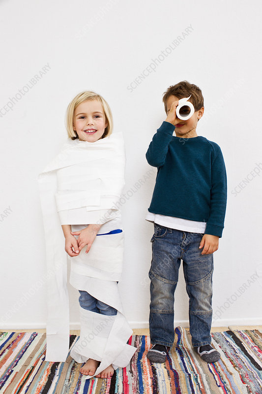Sister and brother with toilet rolls