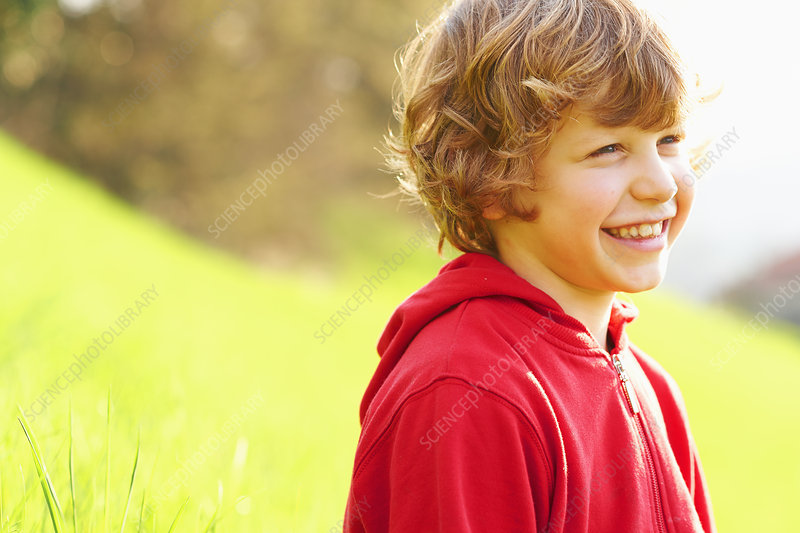 Young boy in grassy field