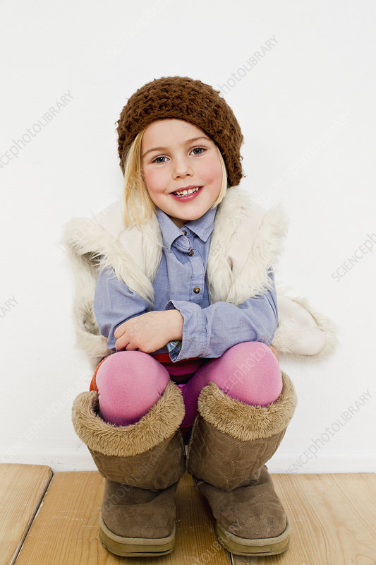 Young girl in oversize boots