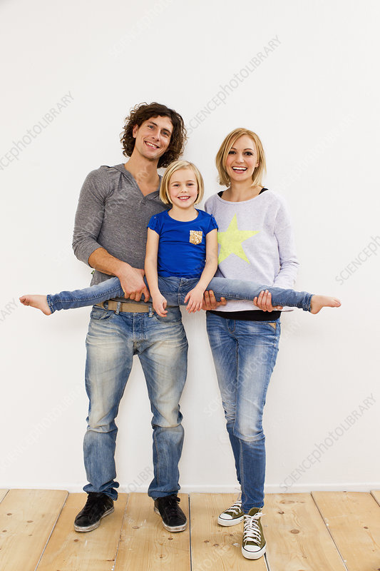Couple holding up daughter