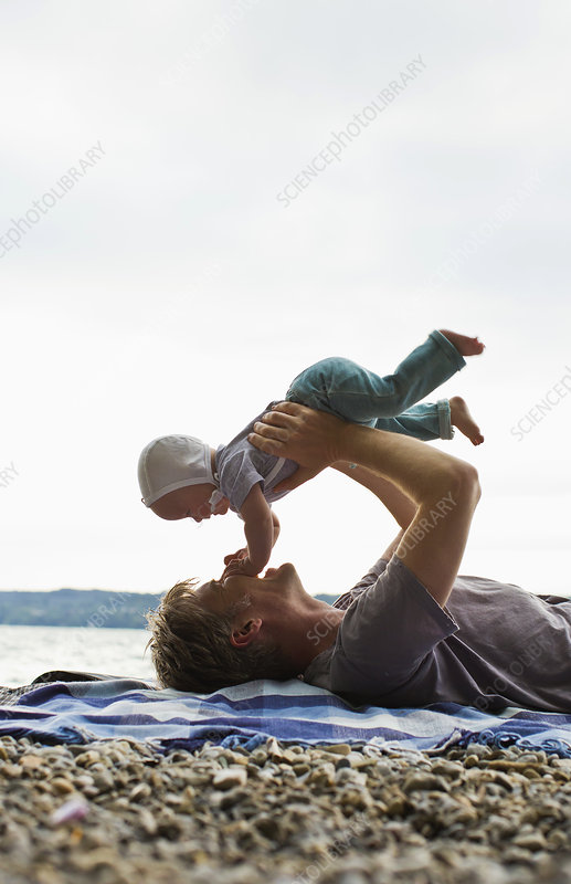 Father lifting baby daughter