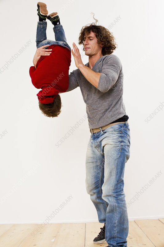 Father turning over son in mid air