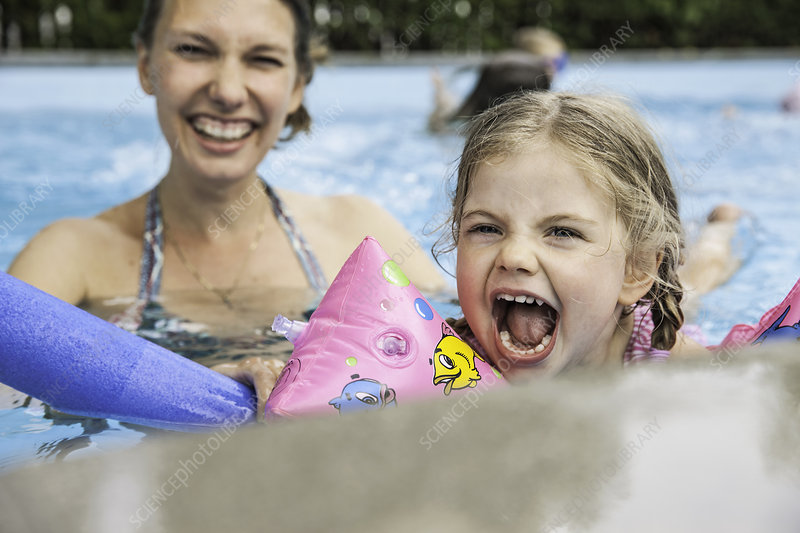 Mother and child having fun in pool