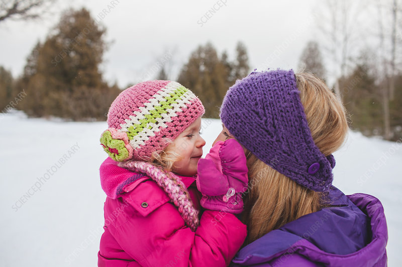 Mother and daughter in snow