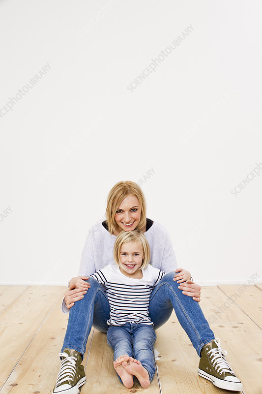 Studio portrait of mother and daughter