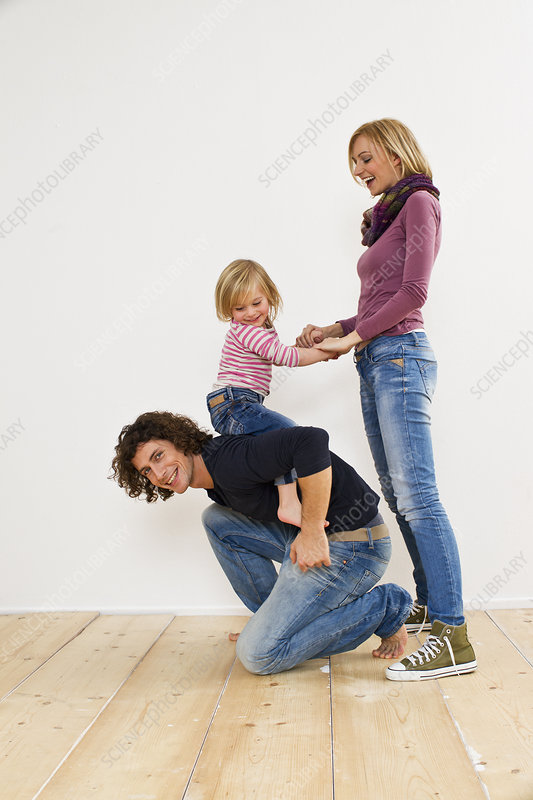 Studio shot of couple with young daughter