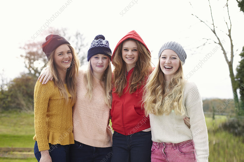 Four teenage girls in knitted hats