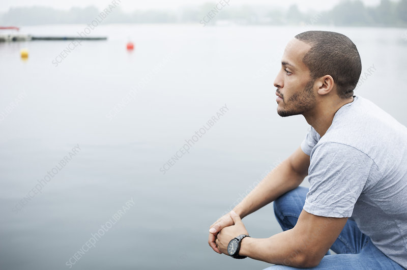 Portrait of young man by lake