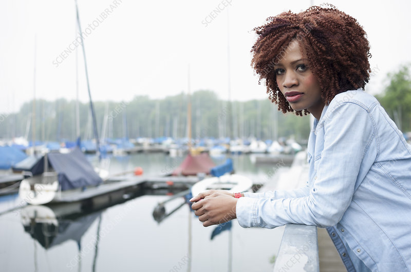 Portrait of young woman in marina