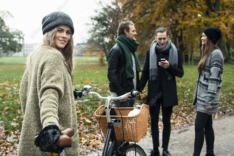 Woman with bike, friends in background