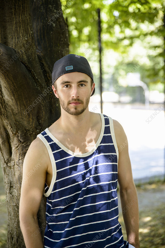 Male basketball player in park