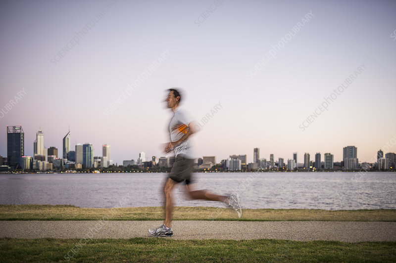 Male running along waterfront