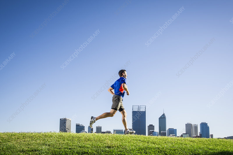 Male running through park