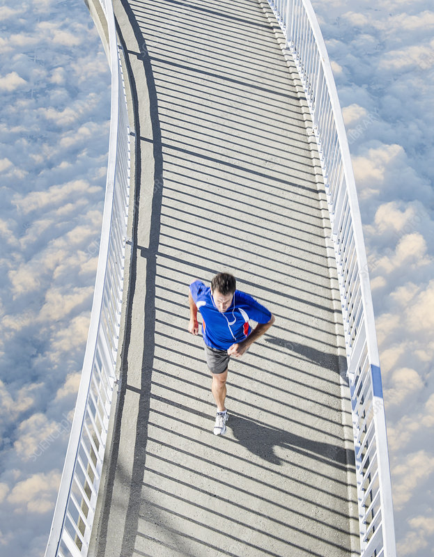 Man running above the clouds
