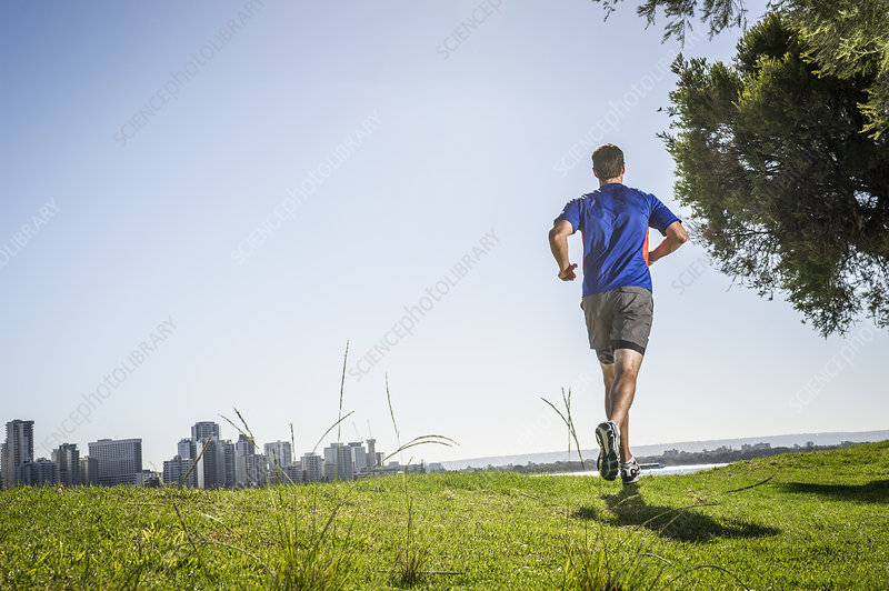 Man running in park, Perth, Australia