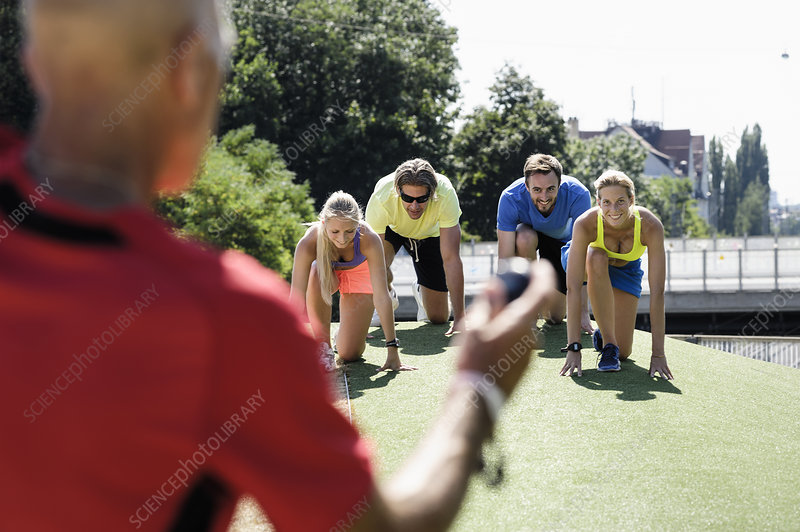 Man training a group of adult runners