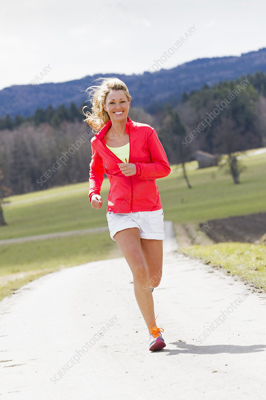 Mid adult woman jogging