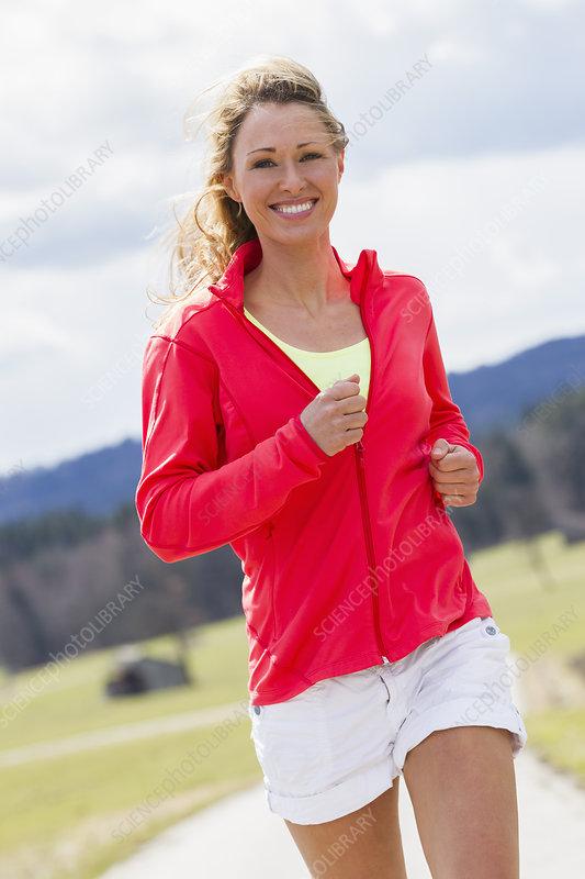 Mid adult woman jogging