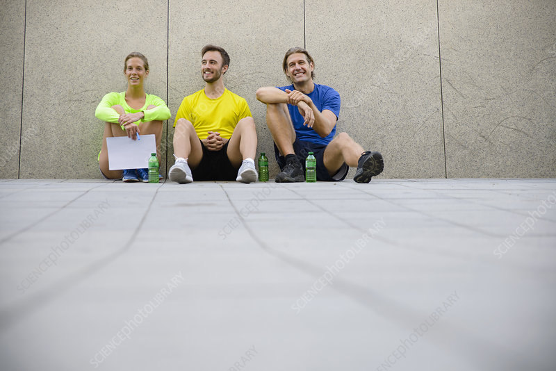 Three friends wearing sports clothing