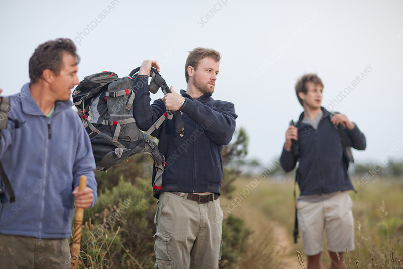 Three men hiking with backpacks