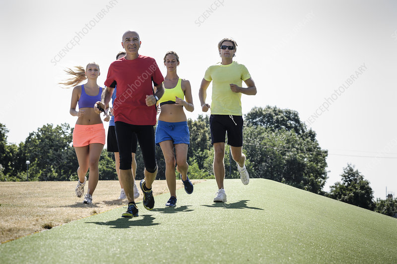 Trainer running with group of adults