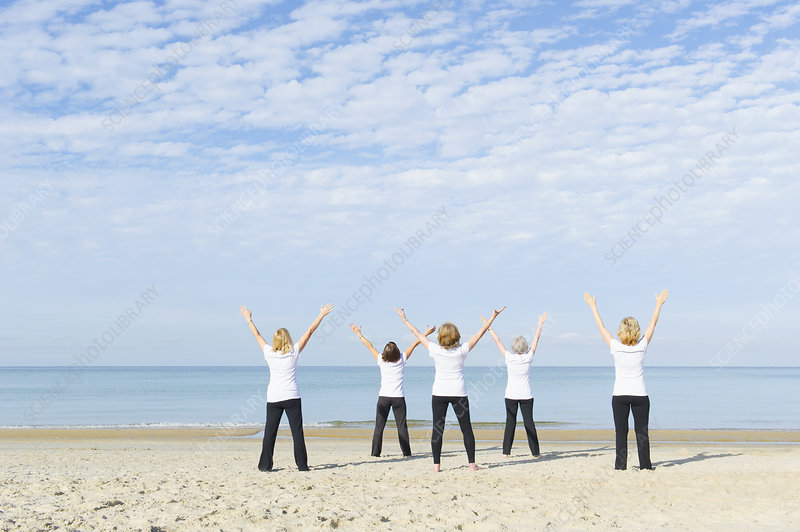 Women enjoying exercise on beach