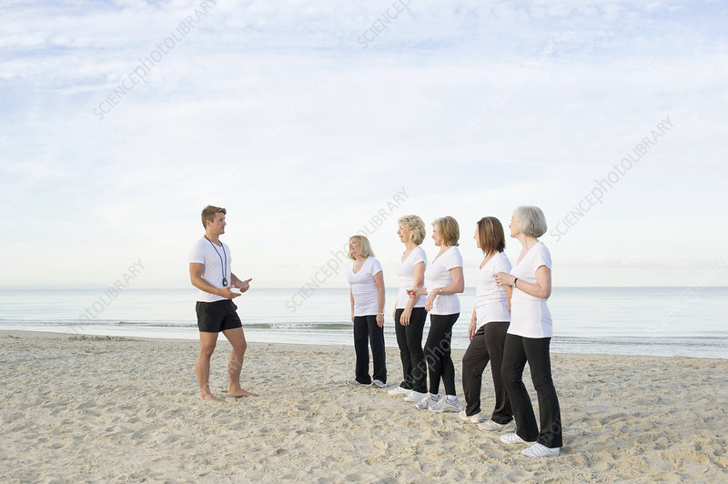 Women with their trainer on beach