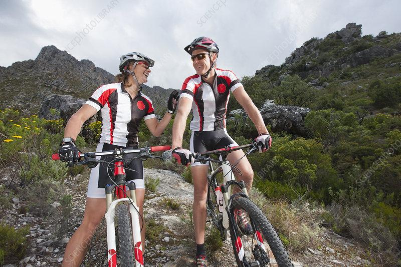 Young couple on mountain bikes