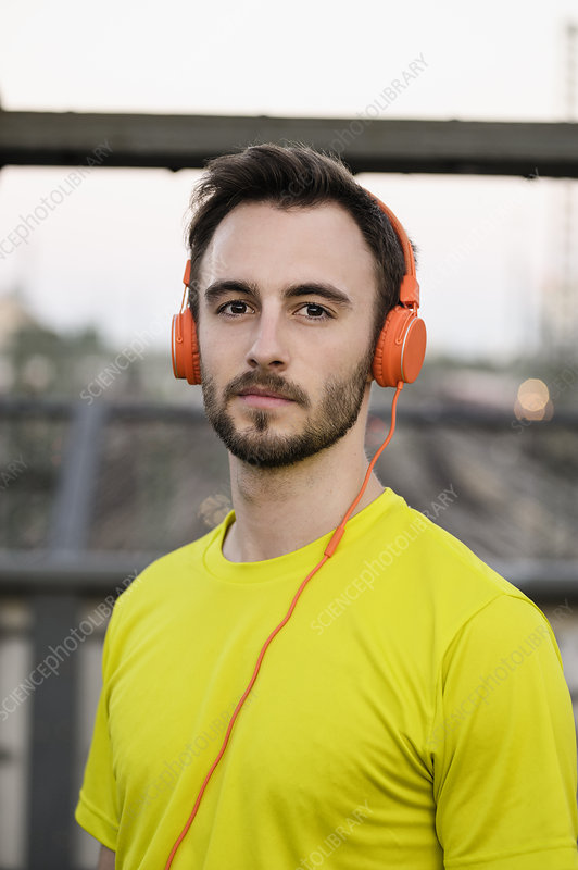 Young male runner wearing headphones
